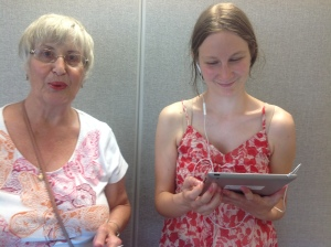 Tina and an older woman looking at an IPad.