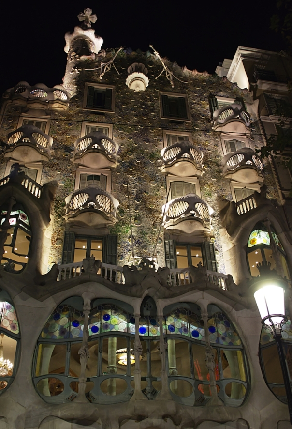 the facade of the Casa Batllo lit in the dark