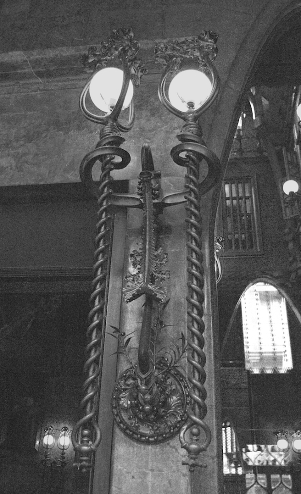 a lamp and walls inside the Palau Guell