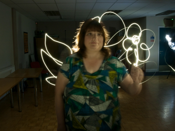 a woman with wings painted with light