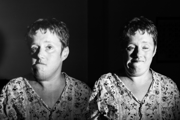 Light Painting of the same woman twice in one picture, she makes faces
