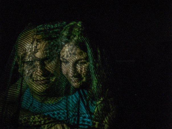Light painting of a man and a woman through a net scarf